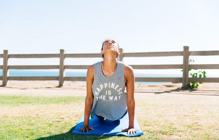 Christen Press doing yoga