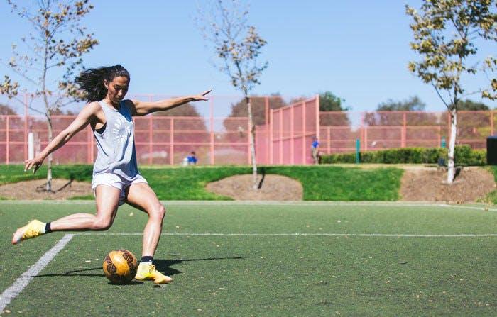 Christen Press playing soccer