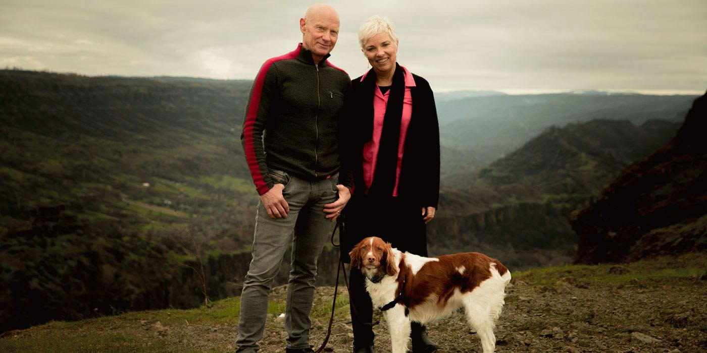Clif Bar Owners Gary and Kit outside with dog