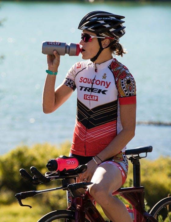 Biker drinking from water bottle