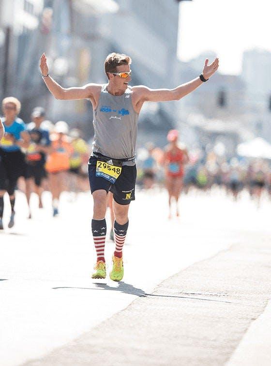 Runner arms raised Boston marathon