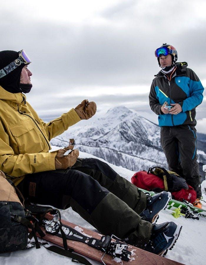 Skiers take snack break on mountain