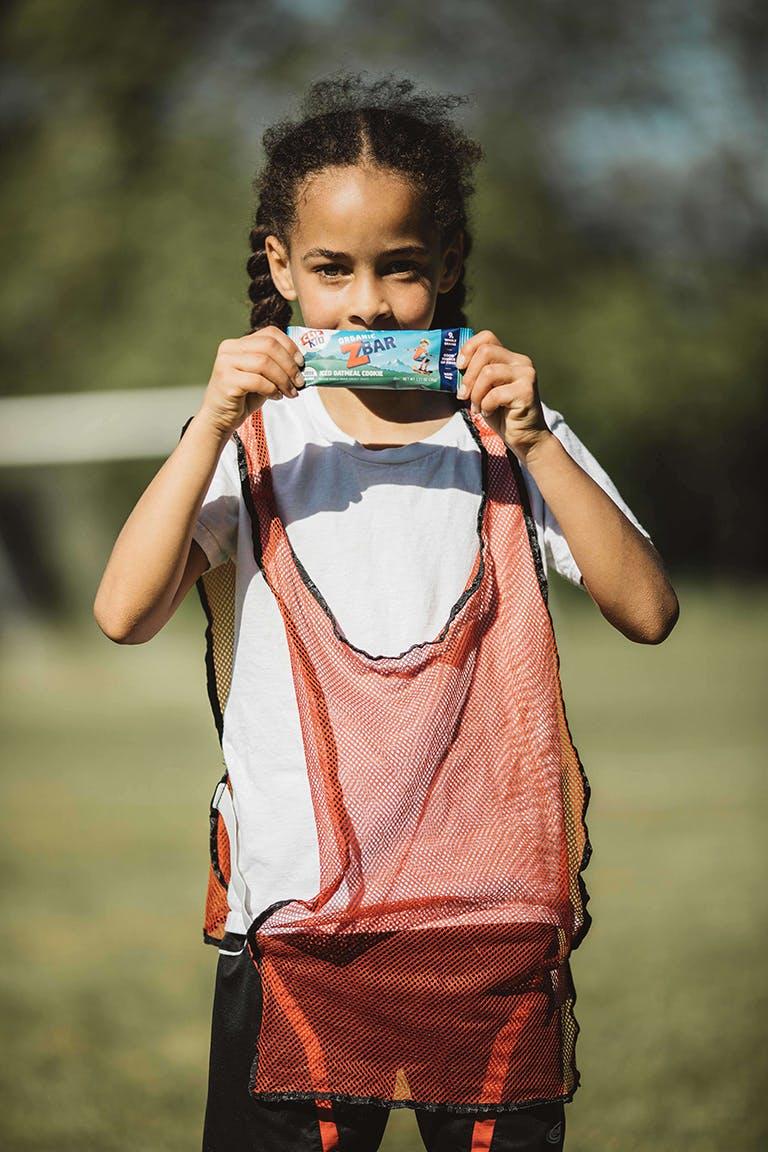 Soccer girl holding zbar