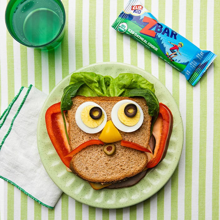 Sandwich with face on green stripes