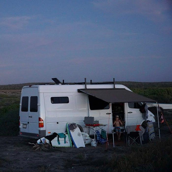 Sprinter van camping at sunset