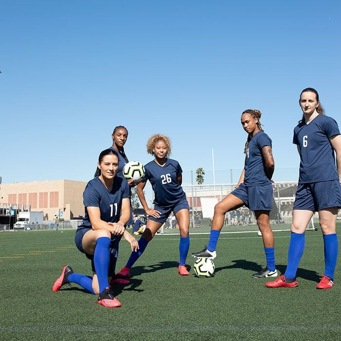 US Women's National Soccer Team posing with ball