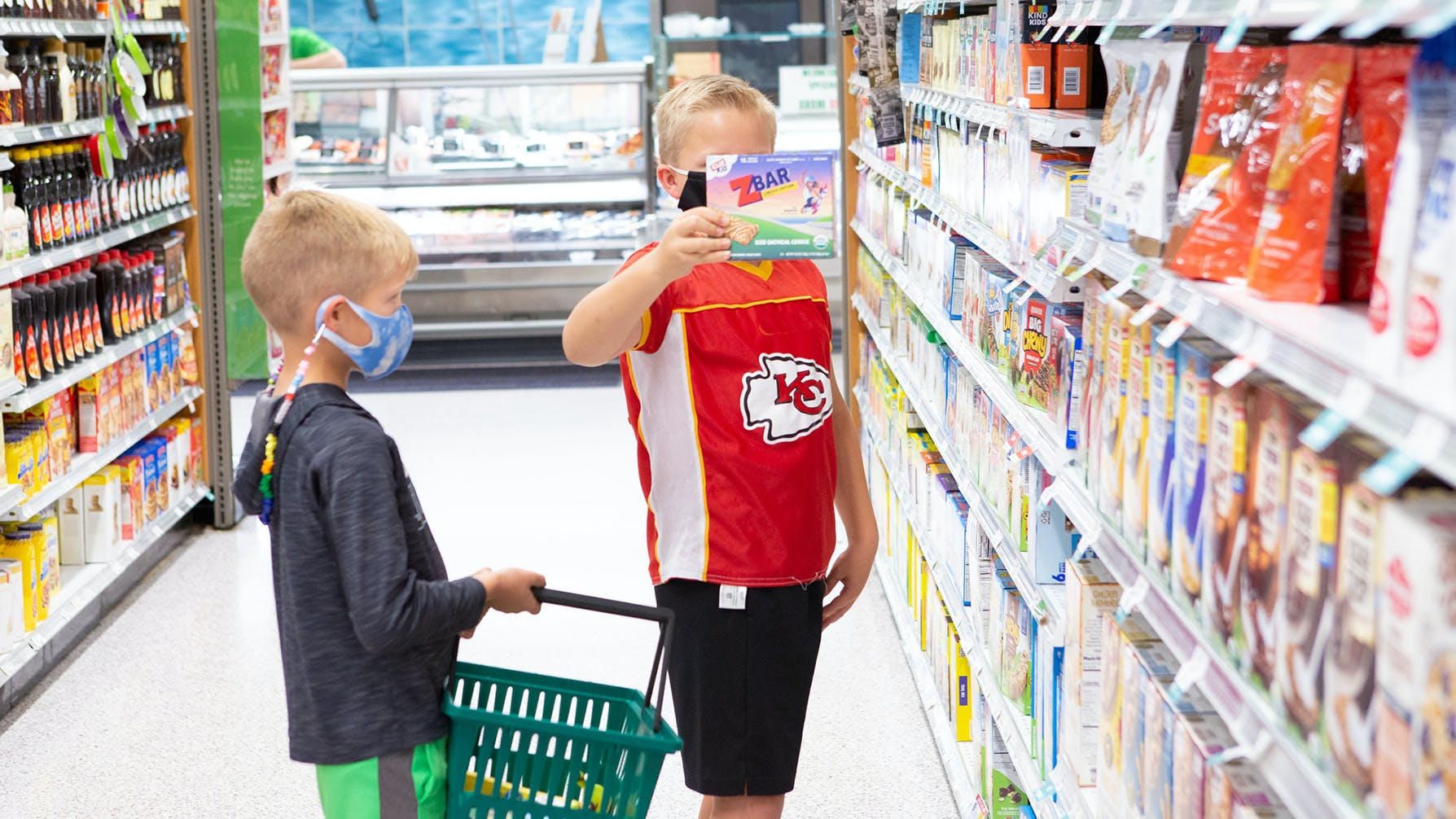 Kids picking out CLIF Kid Zbars at grocery store