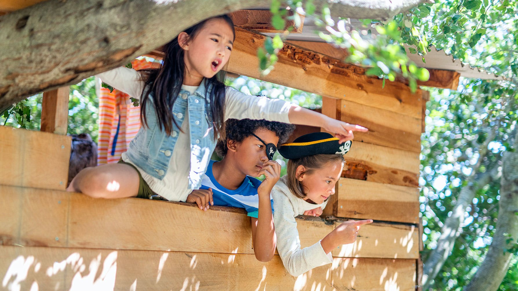 Kids playing in a treehouse outside