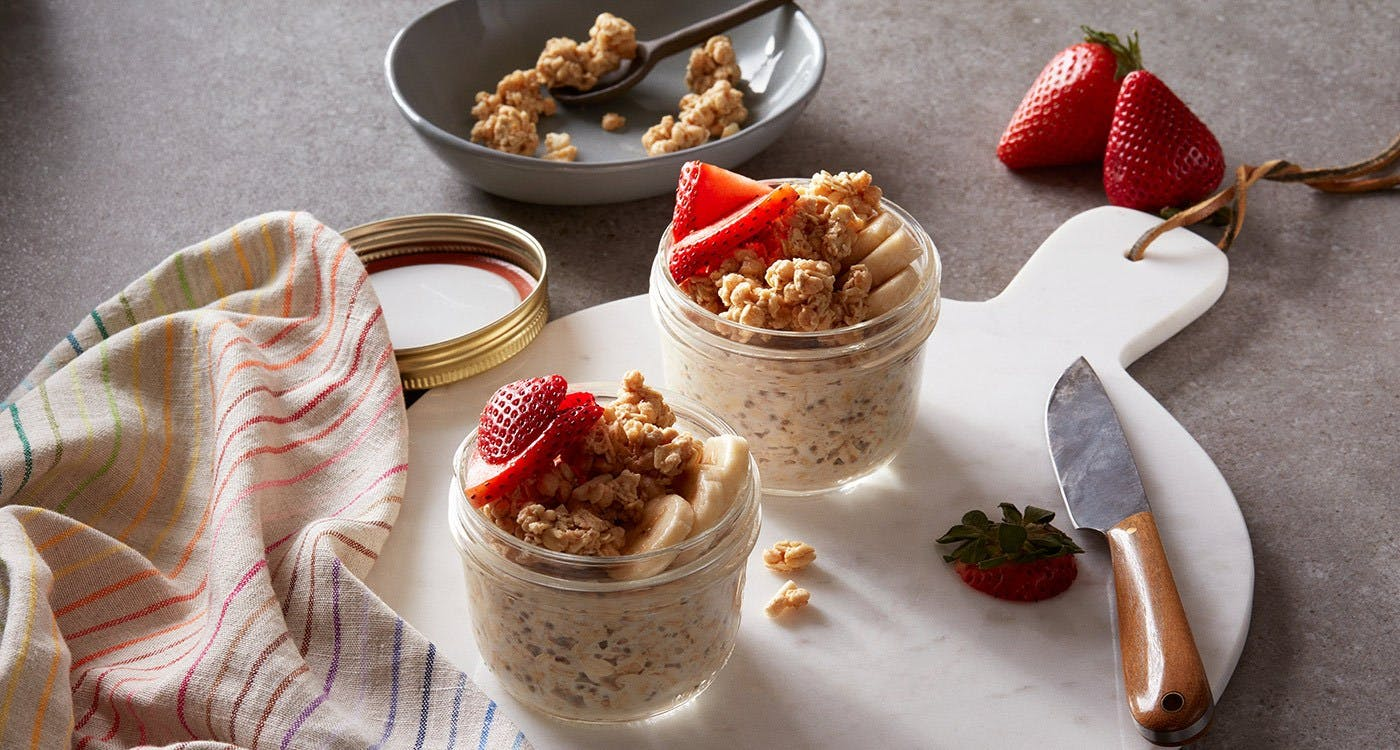 Overnight Oats with granola, strawberries, and bananas