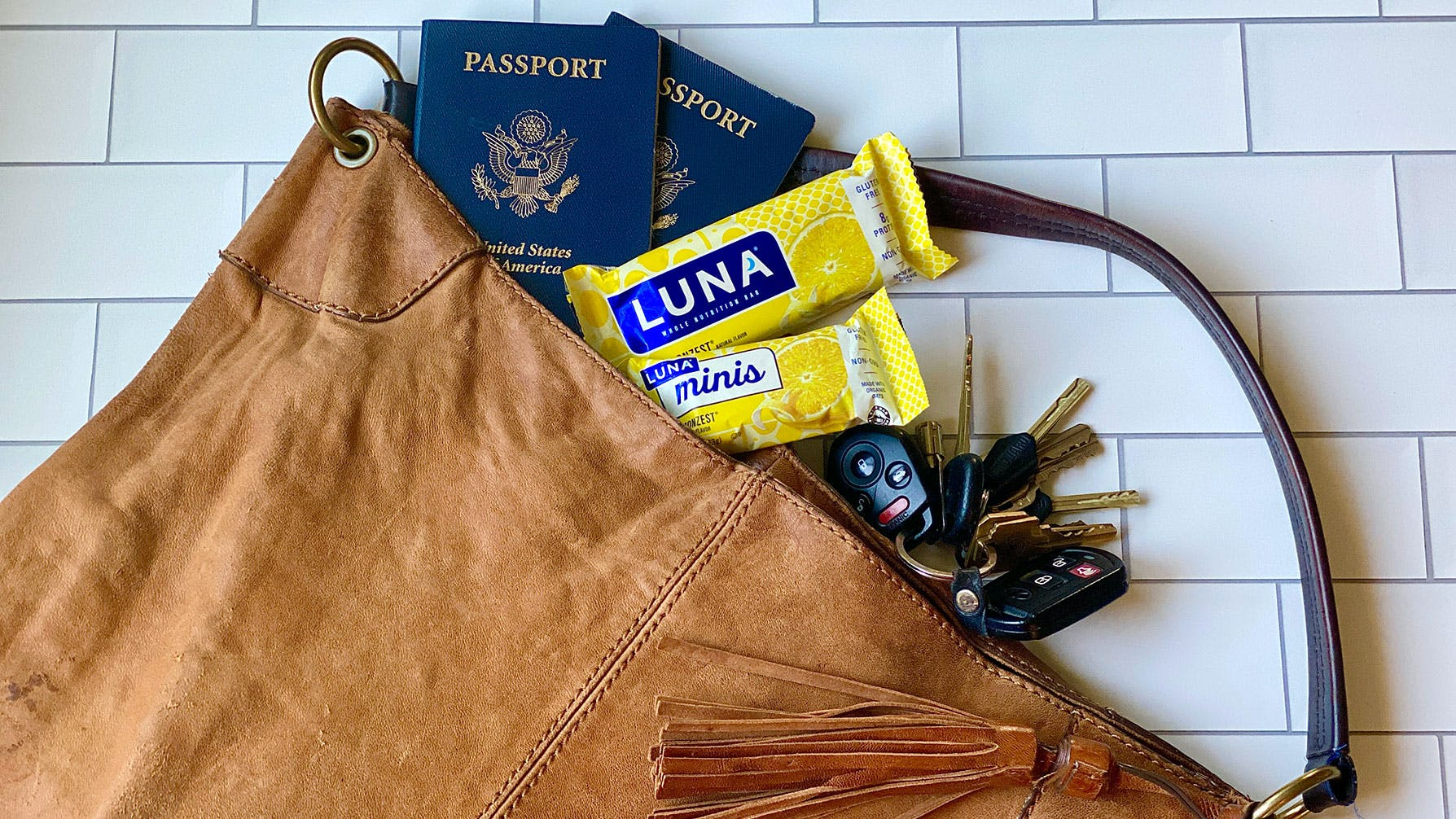Purse packed with passports and LUNA Bars