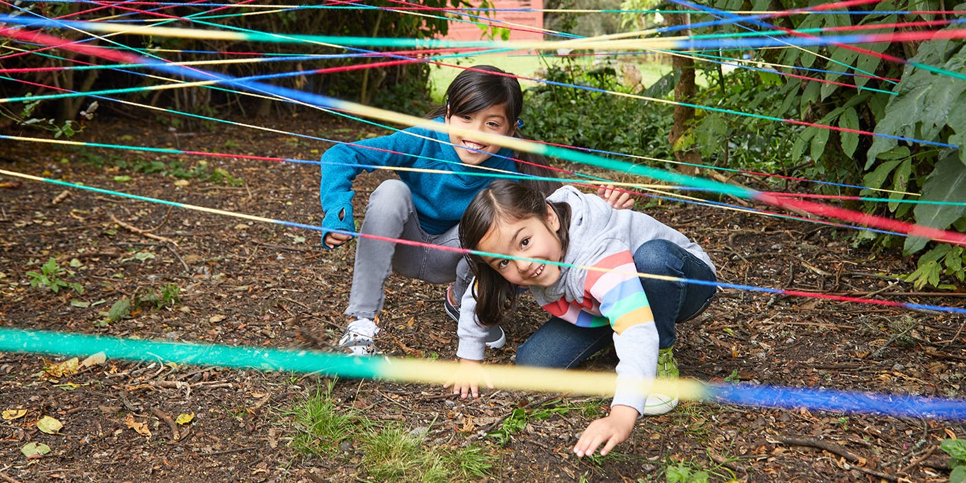 Girls playing in rope obstacle course