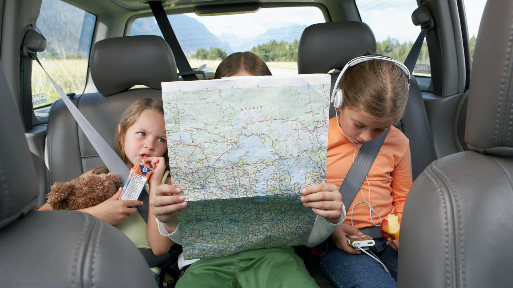Kids with map on road trip