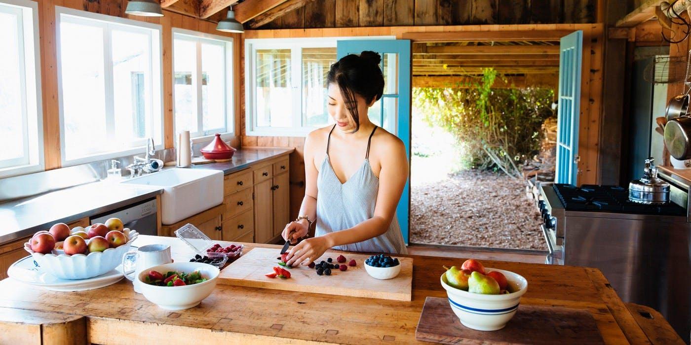 Woman preparing fruit in her kitchen