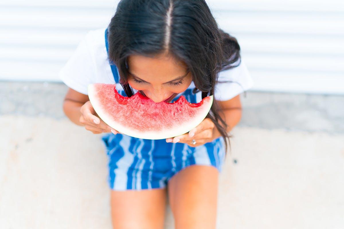 Woman eating watermelon slice