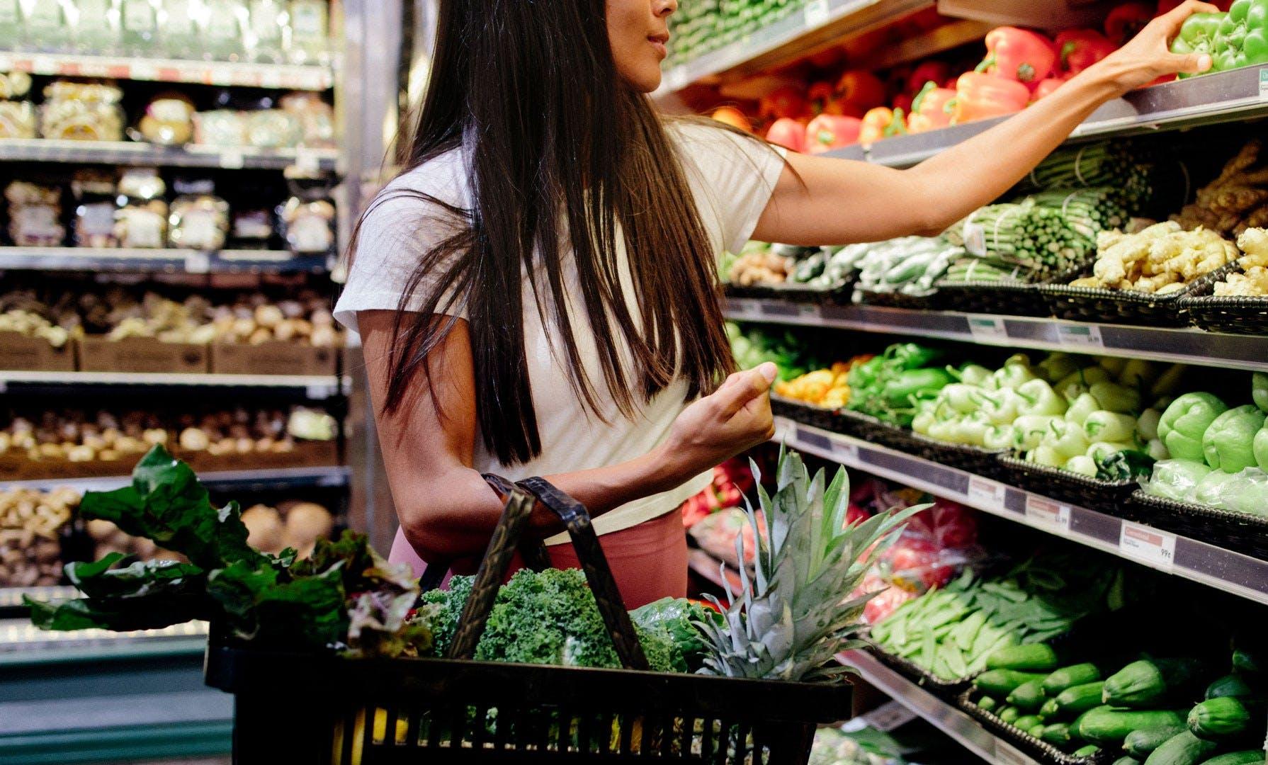 Woman grocery basket produce